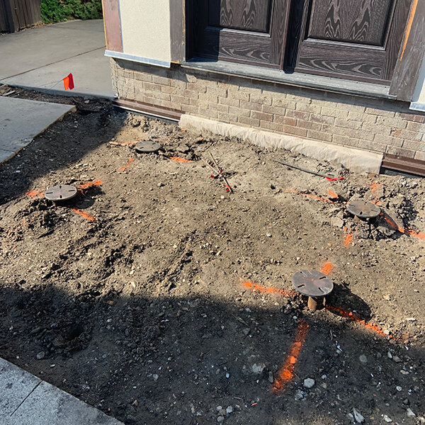 """2 7/8"""" screw piles used to support a front step in Millwoods"""